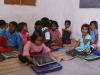 Kinderen van groep 2 in een nieuw lokaal